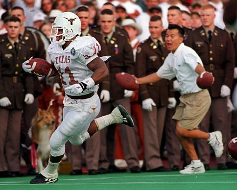 Ricky Williams is chased by an overenthusiastic ballboy as he sets the NCAA all-time rushing touchdown record that Moose is chasing.